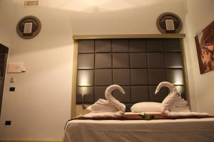 A bed or beds in a room at Dolce Vita Rooms & Breakfast
