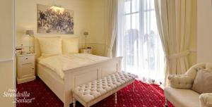 A bed or beds in a room at Strandvilla Seelust