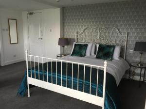 A bed or beds in a room at Lamlash Bay Hotel