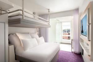 A bunk bed or bunk beds in a room at YOTEL Boston