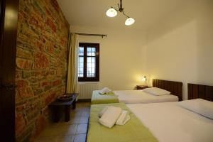 Ένα ή περισσότερα κρεβάτια σε δωμάτιο στο Esperos Suites & Villas