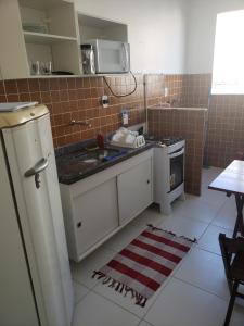 A kitchen or kitchenette at Apartamento Bento