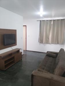 A seating area at Apartamento Bento