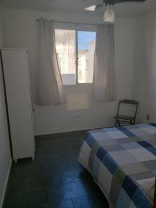 A bed or beds in a room at Apartamento Bento