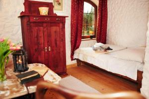 A bed or beds in a room at Ciche wody