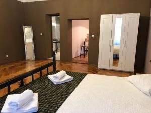 Cama ou camas em um quarto em Poet Pastior Residence
