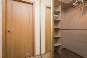 Телевизор и/или развлекательный центр в 5days-nn, Апартаменты на Карла Маркса 45