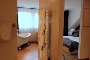 A bathroom at ART Hôtel