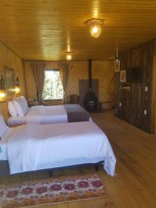 A bed or beds in a room at Pousada Serra Catarinense