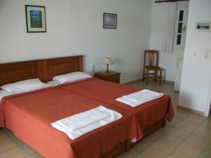A bed or beds in a room at Nicolas Rooms