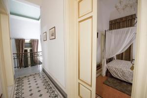 A bed or beds in a room at B&B Pisa Tower