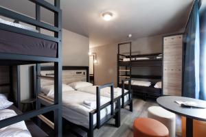 A bunk bed or bunk beds in a room at a&o Warsaw Wola