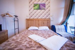 Кровать или кровати в номере Гостевой Дом Горная Лаванда