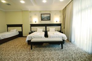 Cama ou camas em um quarto em New Baku Hotel