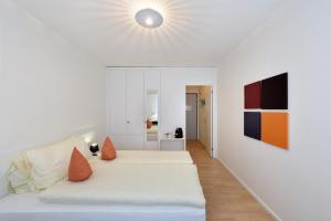 Un pat sau paturi într-o cameră la Apaliving - Budgethotel