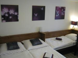 A bed or beds in a room at Penzion Gerta