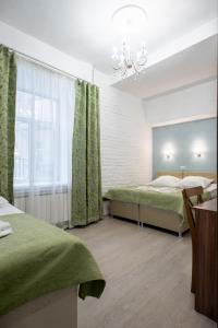 Кровать или кровати в номере Мини-отель Адъютант