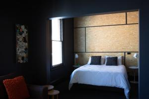 A bed or beds in a room at The Franklin Boutique Hotel