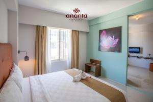 A bed or beds in a room at Ananta Legian Hotel
