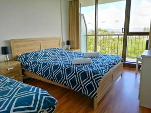 A bed or beds in a room at Anacapri Holiday Resort Apartments