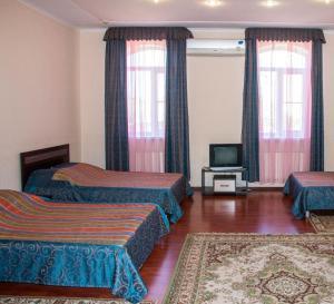 Кровать или кровати в номере Отель Дама с Собачкой