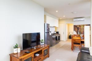 A television and/or entertainment center at ON TOP OF THE WORLD - BEST VIEWS IN MELBOURNE !!