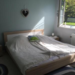 Ein Bett oder Betten in einem Zimmer der Unterkunft Apartments Friesenglück