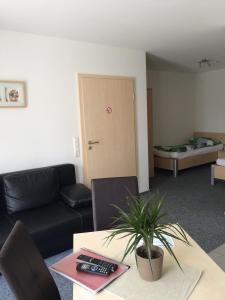Ein Sitzbereich in der Unterkunft Apartmenthaus Gärtner