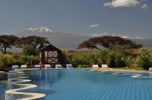 The swimming pool at or near Kilima Safari Camp