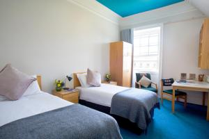 A bed or beds in a room at Trinity College - Campus Accommodation