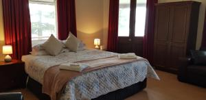 A bed or beds in a room at Bompas Boutique Hotel