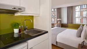 A kitchen or kitchenette at Citadines South Kensington London