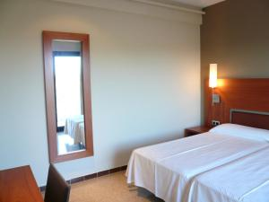 A bed or beds in a room at Can Fisa Hotel & Apartments
