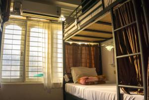 A bed or beds in a room at Hostel9 Yangon