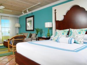 A bed or beds in a room at Ocean Key Resort & Spa, a Noble House Resort
