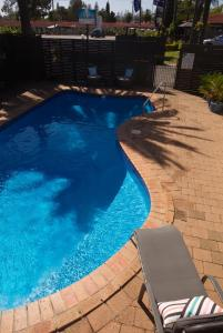 The swimming pool at or near Tuncurry Motor Lodge