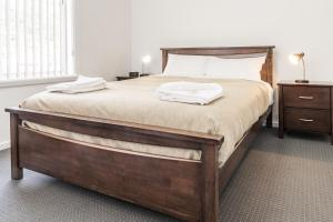 A bed or beds in a room at Somerset Hotel