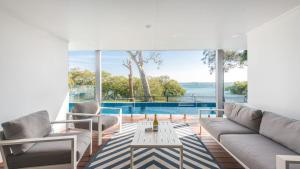 The swimming pool at or near Hamptons Coastline Retreat- Waterfront with a Heated Pool