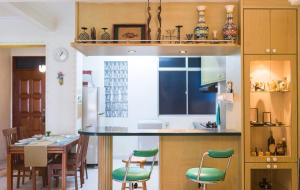A kitchen or kitchenette at Glory's Cozy home stay