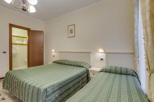 Cama ou camas em um quarto em Hotel Universo & Nord