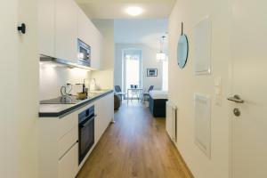 Kuchyň nebo kuchyňský kout v ubytování The BL42 Concept Apartment