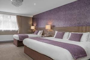 A bed or beds in a room at Best Western Burnley West Higher Trapp Hotel