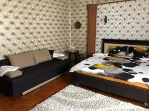A bed or beds in a room at Schei Studio 1