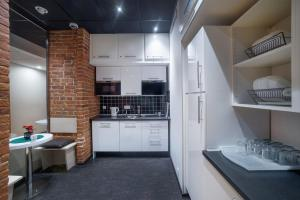 A kitchen or kitchenette at Vinegret Hostel