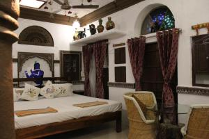 A bed or beds in a room at Castle View Home stay