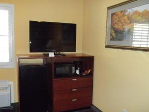 A television and/or entertainment center at Southern Inn and Suites Yorktown