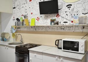 Кухня или мини-кухня в Хостел Авиатор на Пушкинской