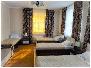 Кровать или кровати в номере TwinHouse Karakol