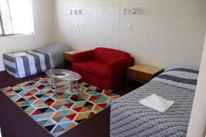 A bed or beds in a room at YAL Cairns - Accommodation that makes a difference