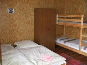 A bunk bed or bunk beds in a room at Fazekas Vendégház és Kemping